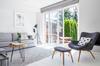 Appartement rez-de-jardin à Rennes – Intérieur d'un appartement avec jardin avec vue sur la terrasse