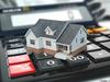 fiscalité à Rennes – Maquette de maison sur les touches d'une calculette