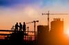 zone activité rennes – chantier coucher de soleil grues
